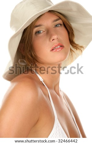 Portrait of young woman wearing bikini and hat isolated on white background - stock photo