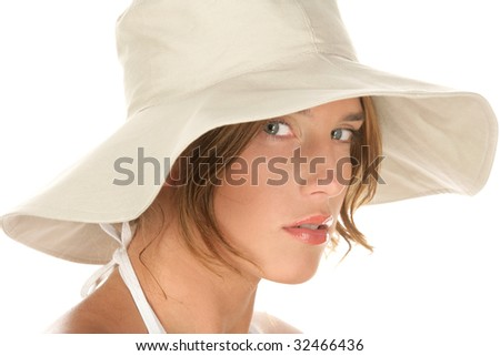 Portrait of young woman wearing hat isolated on white background - stock photo