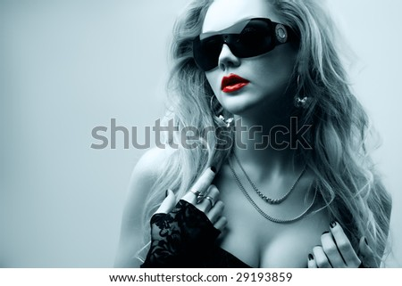 portrait of young woman wearing sunglasses, selective tone - stock photo