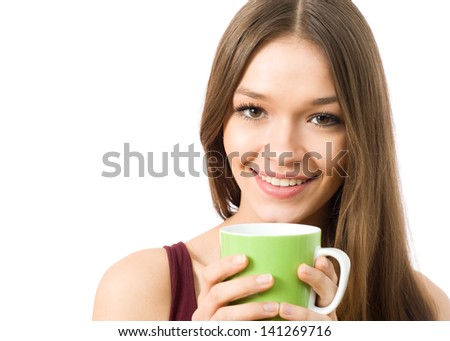 Portrait of young woman with a cup of tea looking at camera - stock photo