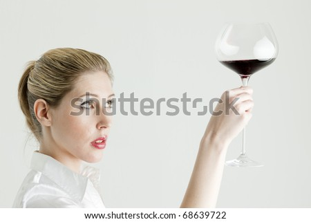 portrait of young woman with a glass of red wine - stock photo