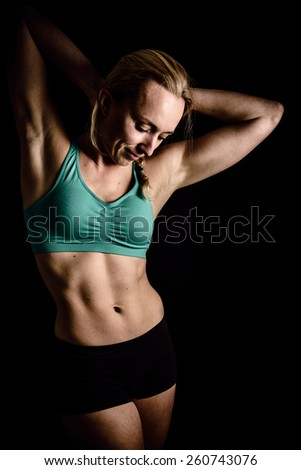 Portrait of young woman with abdominal muscles in color