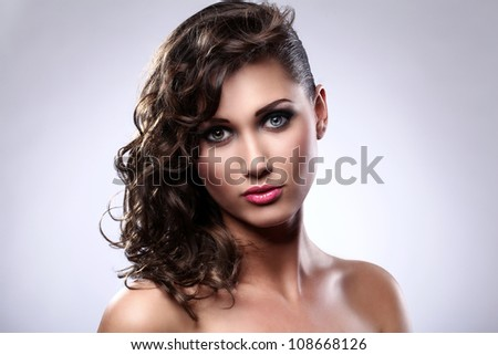Portrait of young woman with beautiful hairstyle and makeup