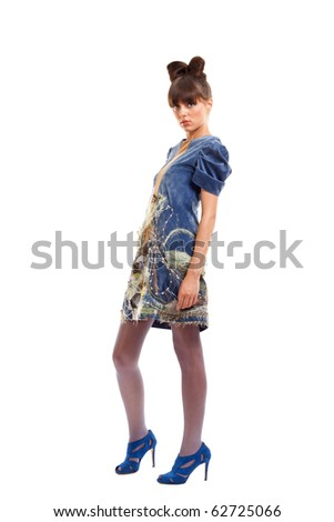 Portrait of young woman with blue dress and high heels