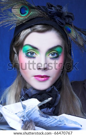Portrait of young woman with bright visage and with paper - stock photo