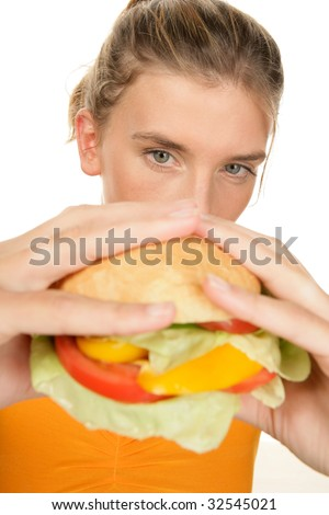 Portrait of young woman with burger isolated on white background - stock photo