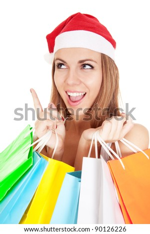 Portrait of young woman with Christmas hat holding white banner and looking aside