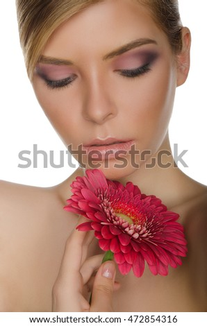 portrait of young woman with chrysanthemum isolated on white