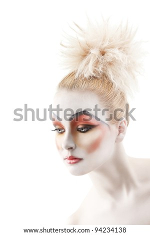 Portrait of young woman with colorful creative make-up like a doll and very cute hair style, she is turned of three quarters and looks down at right - stock photo