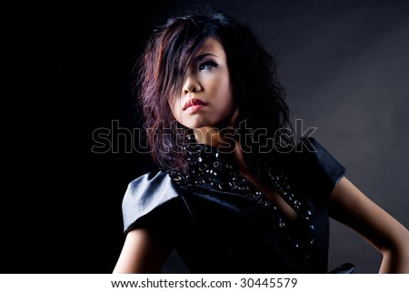 portrait of young woman with creative hairstyle and fashion makeup