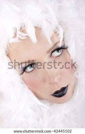 Portrait of young woman with creative makeup on white background