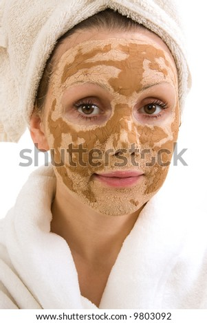 Portrait of young woman with facial mask