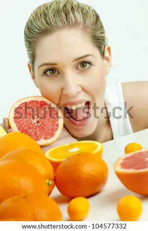 portrait of young woman with grapefruit - stock photo