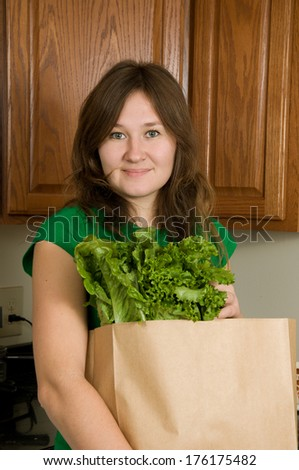 portrait of young woman with greens for healthy food - stock photo