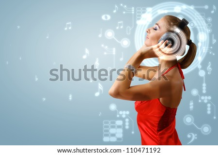 Portrait of young woman with headphones and glittering background - stock photo