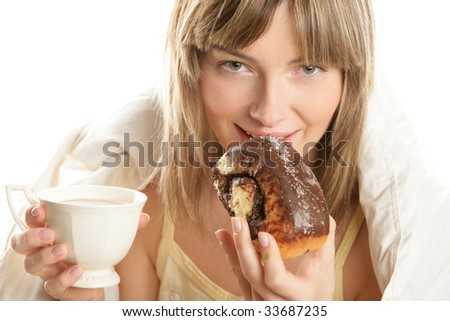 Portrait of young woman with hot chocolate and cake isolated on white background