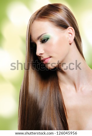 Portrait of young woman with  long straight hair. Blinking Background - stock photo