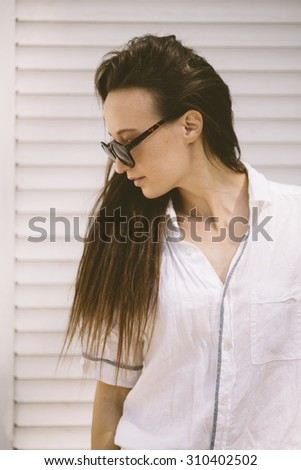 portrait of young woman with retro round sunglasses . - stock photo
