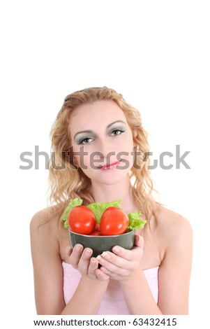 portrait of young woman with salad and tomatoes over white background