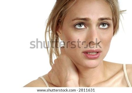 Portrait of young woman with severe neck pain - stock photo