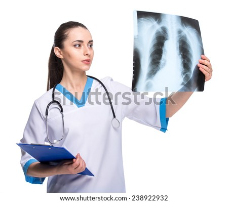 Portrait of young woman with stethoscope and x-ray, isolated on white background. - stock photo