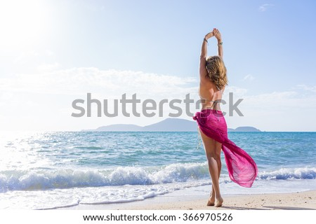 Portrait of young woman with straw hat  on the beach  - stock photo