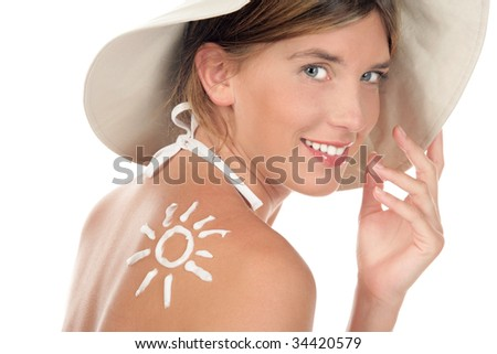 Portrait of young woman with suntan lotion - stock photo