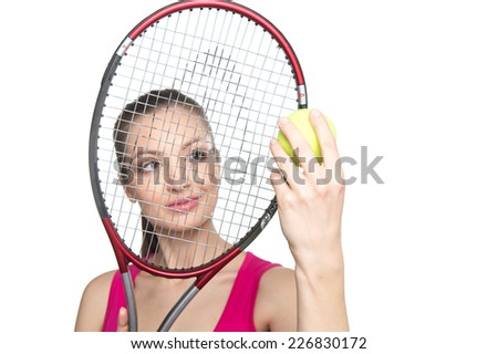 Portrait of young woman with tennis racket isolated on white. closeup on brunette girl holding ball and racket - stock photo