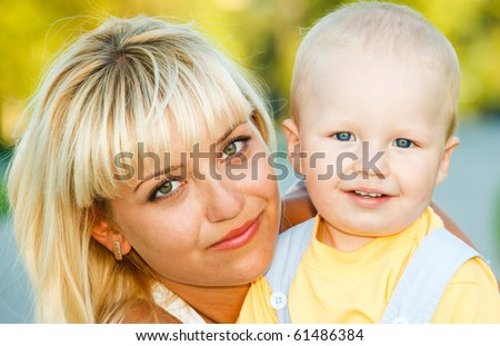 Portrait of young woman with toddler son - stock photo