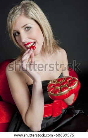 portrait of young woman with Valentine's chocolate box - stock photo