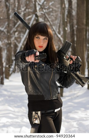 Portrait of young woman with weapon in their hands