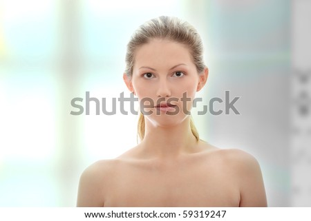 Portrait of young woman without a make-up