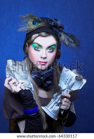 Portrait of young woman witn creative make-up and in vintage hat. - stock photo