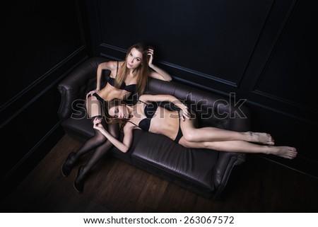Portrait of young women in underwear - stock photo