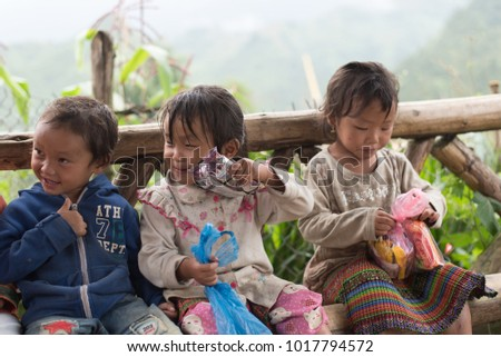 Portrait ofHmong children smiling sitting together at Catcat village   in Sapa, Vietnam.Photo taken at Sapa,Vietnam.Date : October 16,2017.