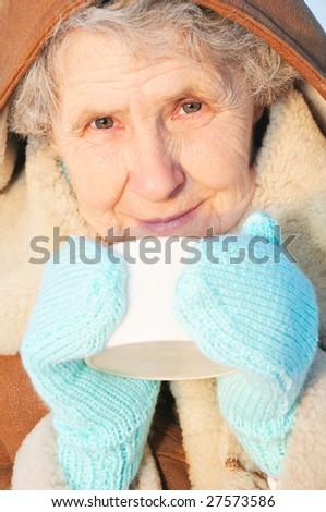 portrait old woman with mug - stock photo