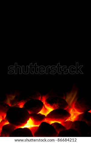 Portrait orientation of hot charcoal fire ready for barbecue with black copy-space - stock photo