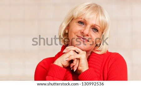 Portrait Photo of a Happy Senior Woman Smiling Friendly - Copyspace for your text - stock photo
