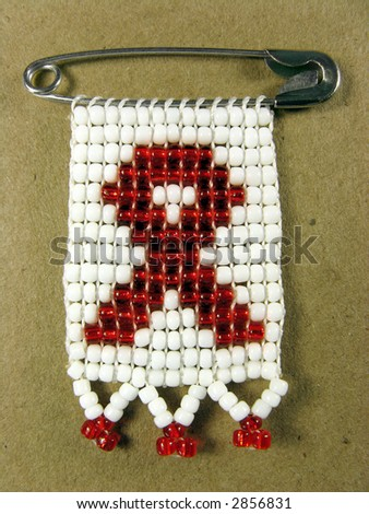 Portrait photo of a traditional african AIDS badge. - stock photo