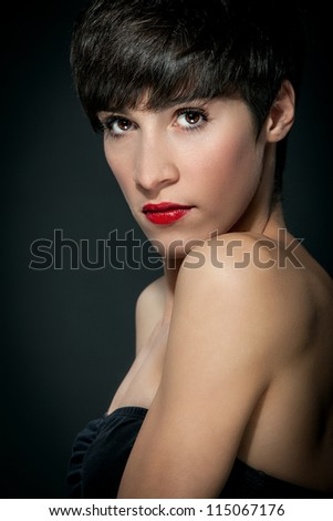 portrait photo of attractive brunette with brown short hairs