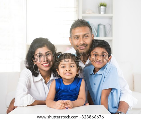 portrait photo of happy indian family - stock photo
