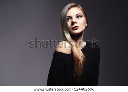 portrait picture of a beutiful young lady on grey background.retouched