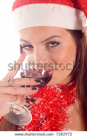 Portrait pretty santa girl drinking red wine