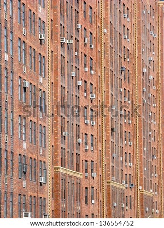 Portrait red brick facade in NYC for background use - stock photo