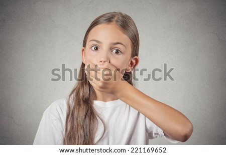 Portrait scared teenager girl looking surprised shocked hand covering mouth, someone shut her up, isolated grey wall background. Human emotions, facial expressions, feelings, body language, reaction - stock photo