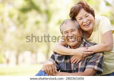 Portrait senior Asian couple in park - stock photo