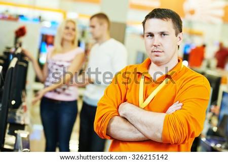 portrait shop assistants in supermarket store - stock photo