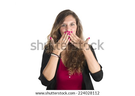 portrait shot of a beautiful caucasian woman. Holding her face in astonishment - stock photo
