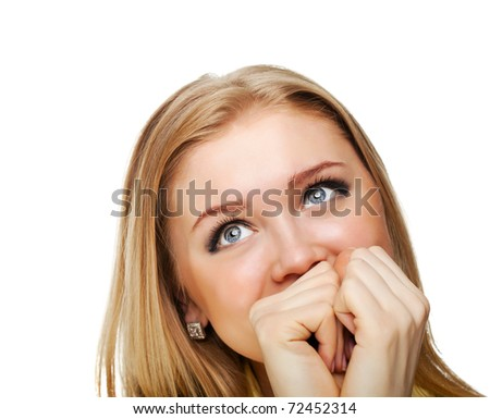 portrait shot of a beautiful caucasian woman. Holding her face in astonishment. - stock photo