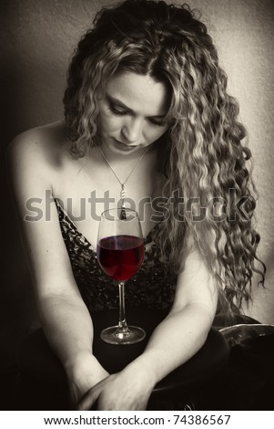 portrait shot of a caucasian woman with a red wine glass